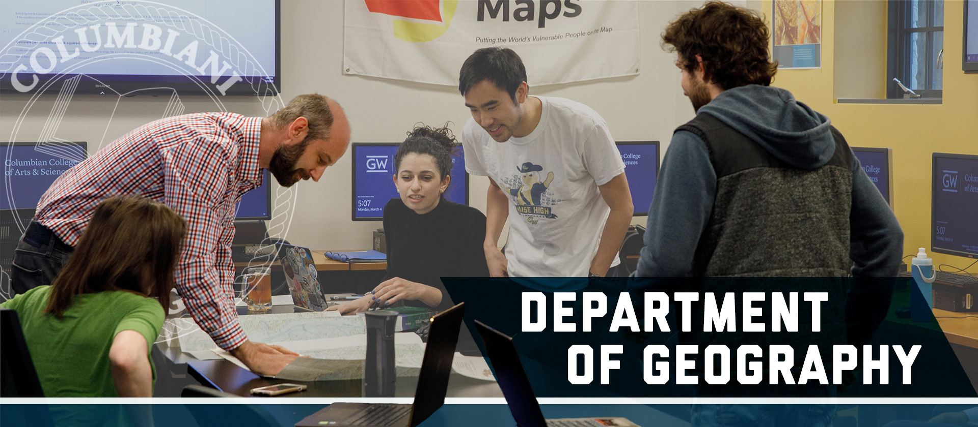 Text: Department of Geography. Geography graduates student surrounding a map in Dr. Mann's GIS class