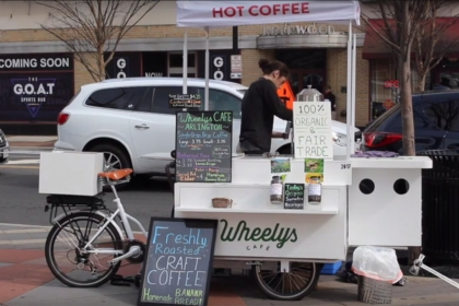 Cameron Waggener working at his Wheelys bicycle coffee shop